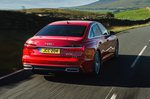 Audi A6 saloon driving away