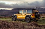 Jeep Wrangler 2019 off-road tracking shot, wide