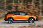 Peugeot 2008 side panning - orange 69-plate car