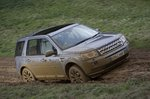 Land Rover Freelander front 3/4 up muddy hill