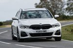 BMW 3 Series Touring 2019 RHD front right cornering