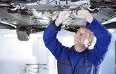 Technician servicing a car