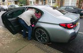 LT BMW 530e - child being lifted out of rear seat