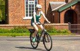Girl riding e-bike 2021