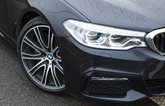 BMW 5 Series alloy wheel and headlight