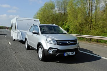 What speed limits apply when towing a caravan or trailer?