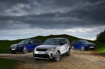 New Land Rover Discovery vs Audi Q7 vs BMW X7 fronts