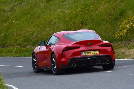 Toyota Supra 2019 RHD rear tracking shot