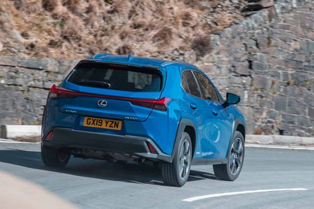 Lexus UX 2019 RHD rear tracking shot