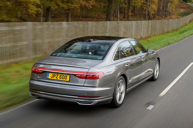 Audi A8 2019 rear right elevated tracking shot