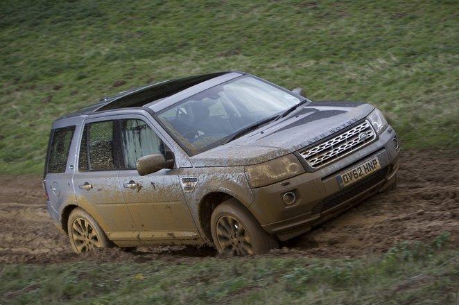 Land Rover Freelander front 3/4 up muddy hill