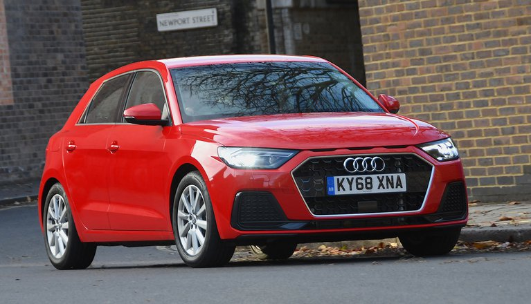 A1 Sportback driving front three-quarter