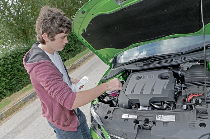 Man checking engine