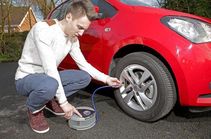 Man checking tyre