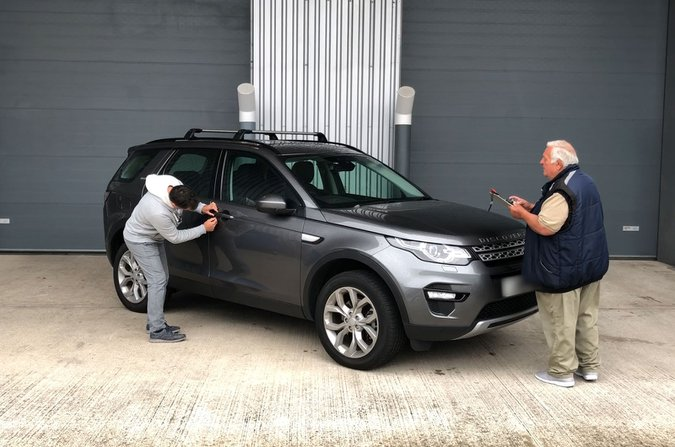 Man attempting to break into a Land Rover