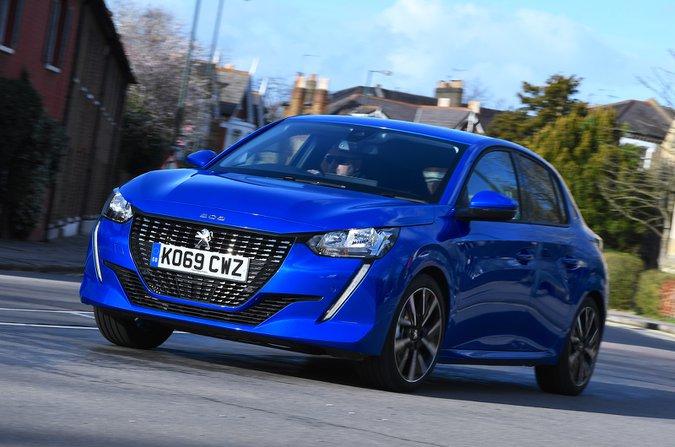Peugeot 208 anteriore - auto blu 69 targhe