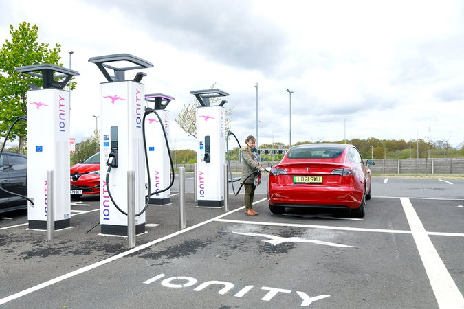 Ionity charging point with Tesla Model 3 21-plate