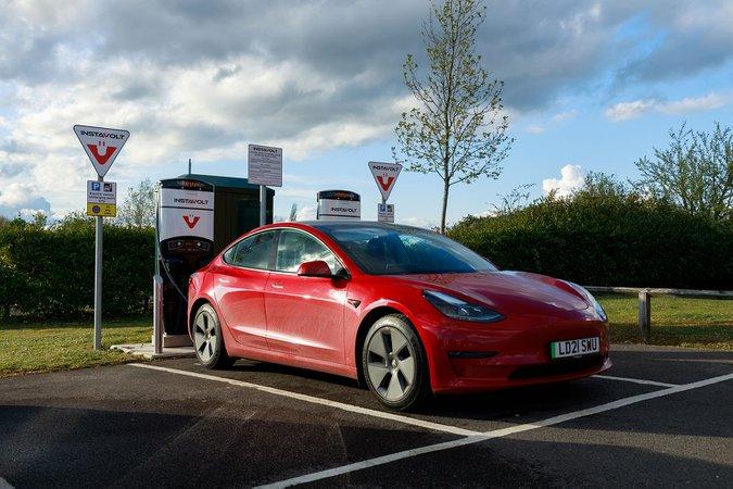 Instavolt charging station with Tesla Model 3 21-plate