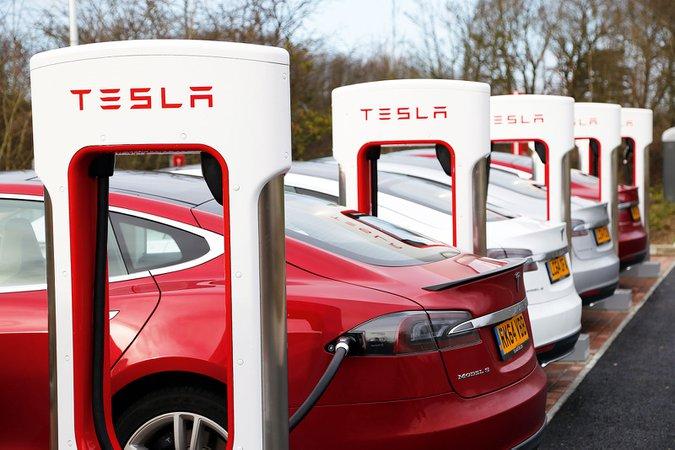 Tesla charging station with Tesla Model S cars