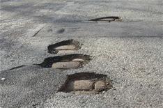 Potholes cost UK motorists millions