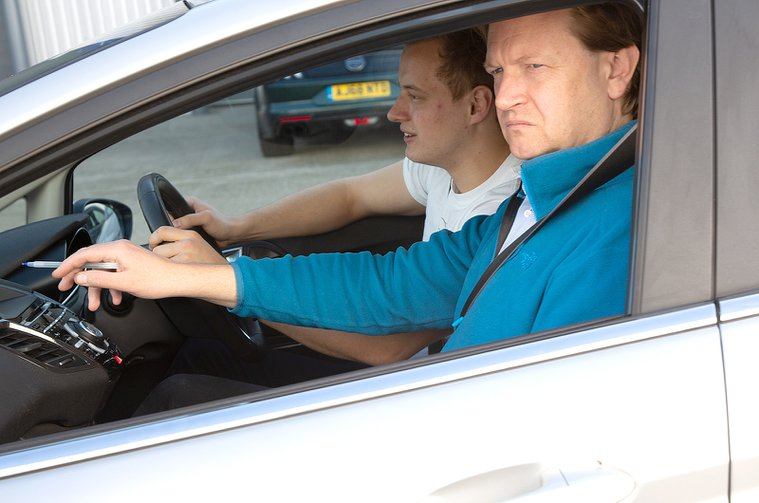 Driving instructor with male student