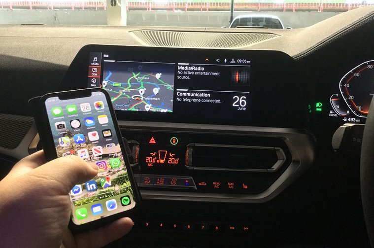 BMW 3 Series interior with mobile phone