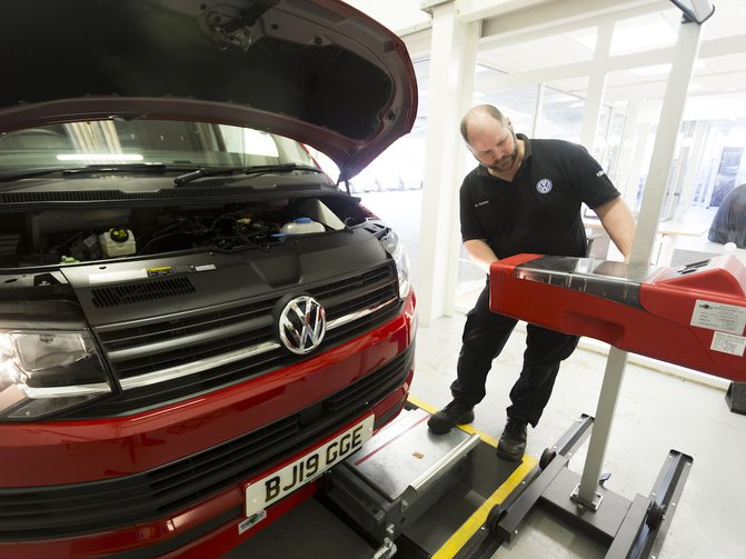 Inside Marshall's Reading Van Centre, the reception desks back onto a bright white vehicle inspection bay with a raft of high-tech diagnostic equipment