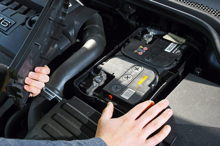 Car battery being checked