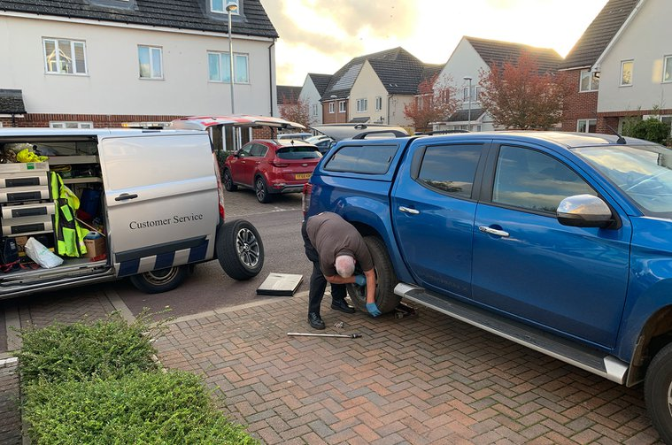 Mitsubishi L200 getting a tyre changed