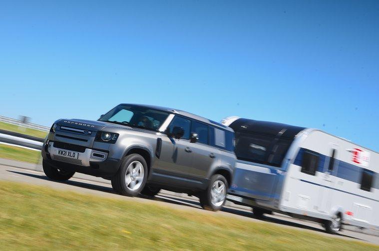 Land Rover Defender pulling a caravan