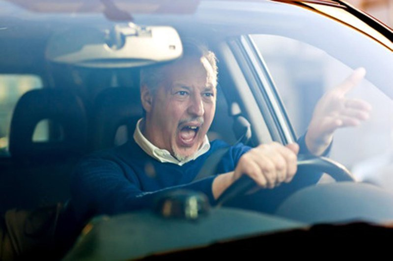 Man honking his car's horn in anger