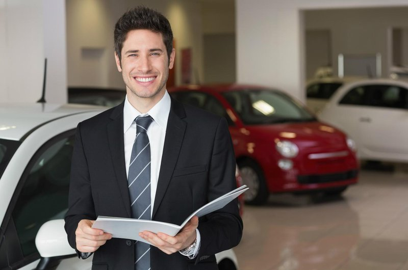 smiling new car salesman