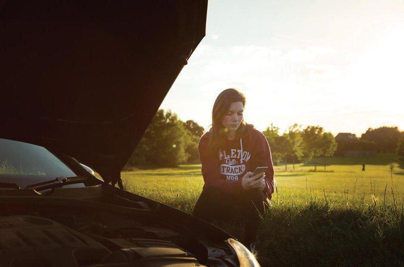 Girl with broken down car