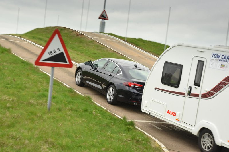 Vauxhall Insignia Grand Sport pulling a caravan up a hill