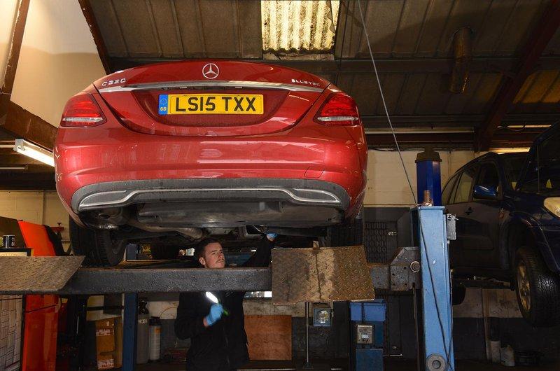 Mercedes-Benz C-Class on ramp in garage