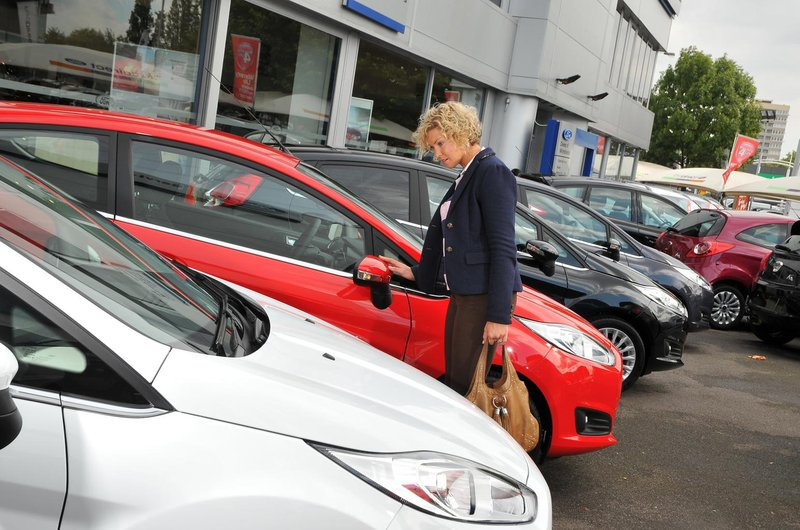 Looking at cars on forecourt