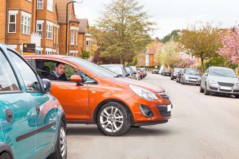Man driving orange car
