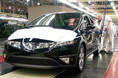 Honda cut pay to save jobs