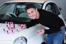 Man to paint car with nail varnish