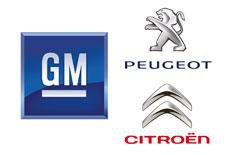 GM buys stake in Peugeot-Citroen