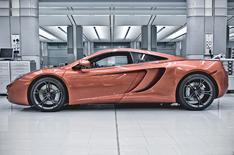 Formula One stars drive McLaren MP4-12C