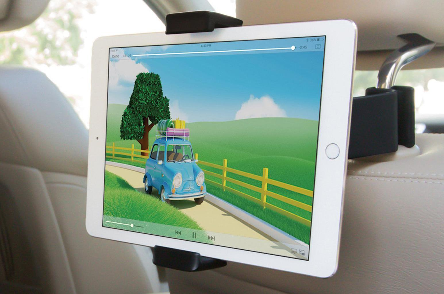 iPad attached to back of car seat using holder