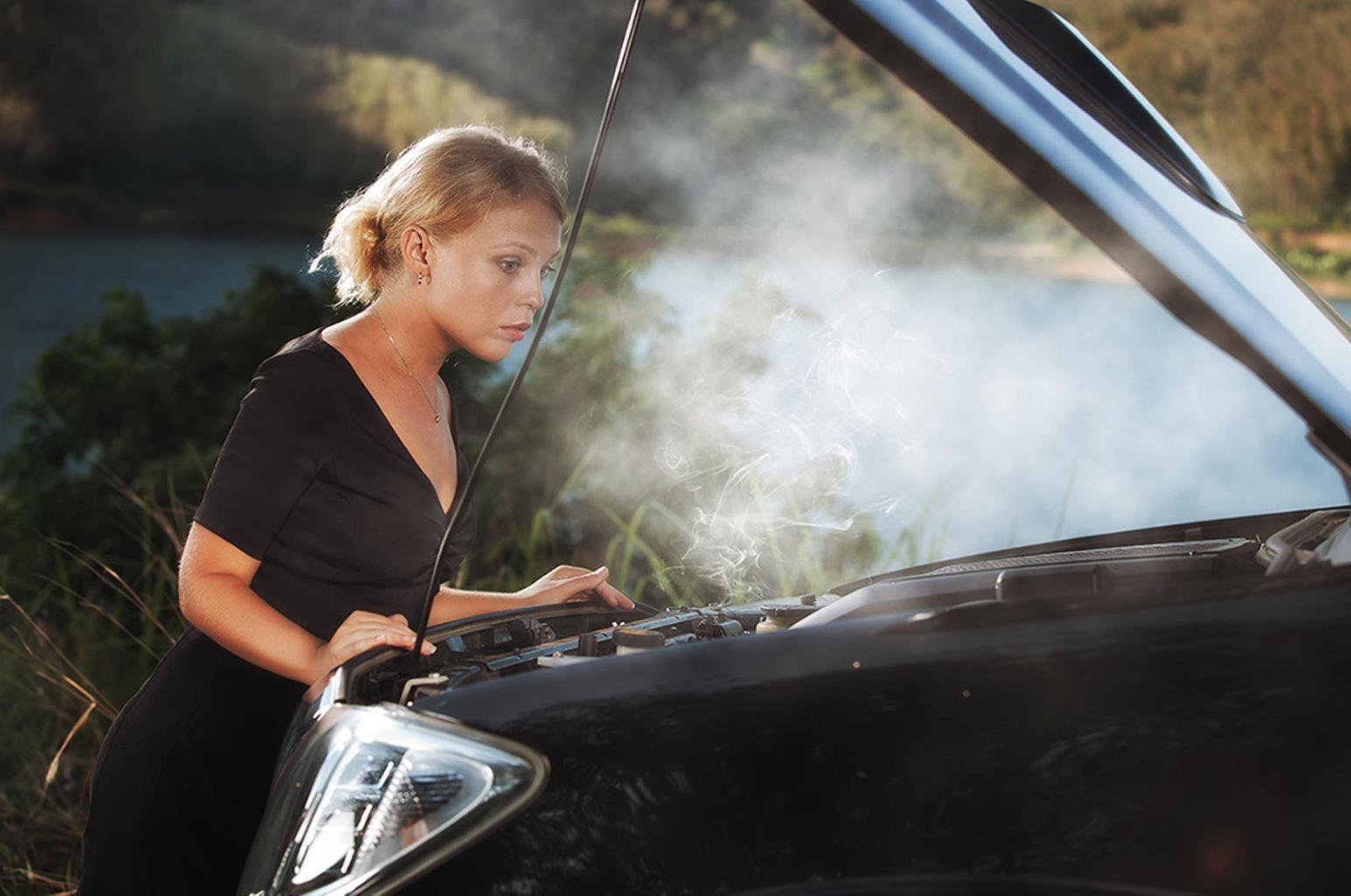 Woman and overheating car