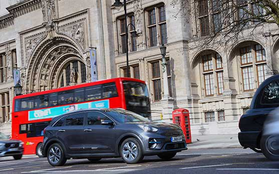 Kia e-Niro in central London with red bus