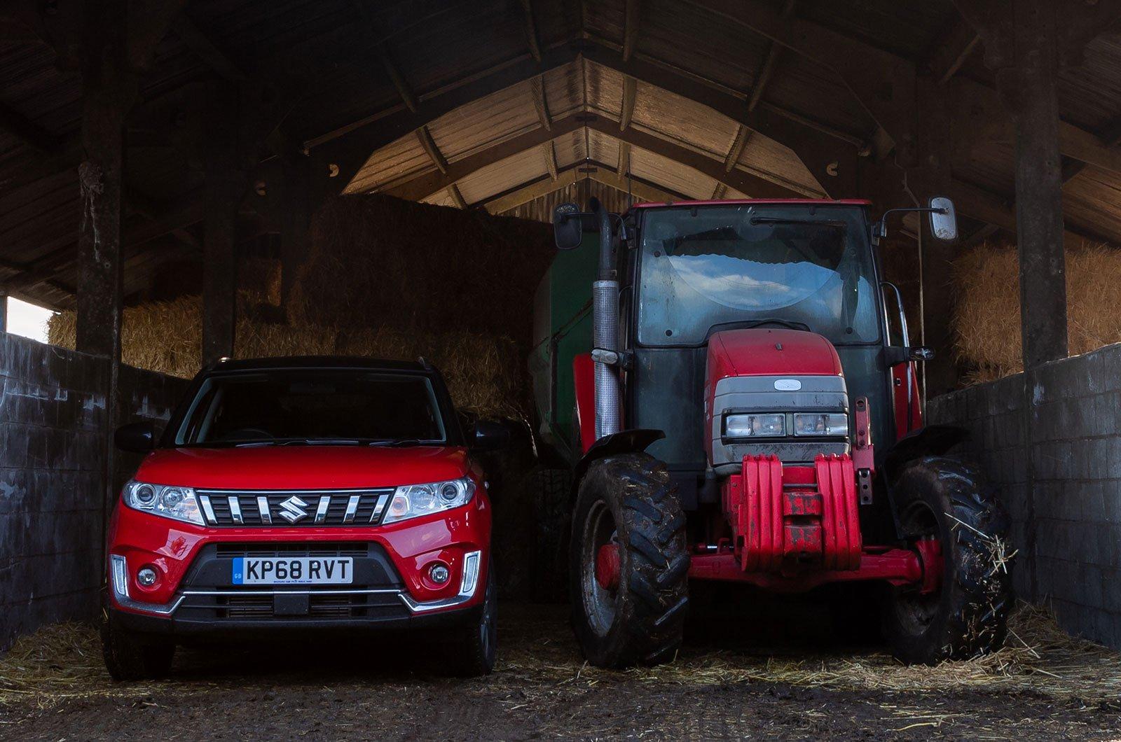 Suzuki Vitara next to a tractor