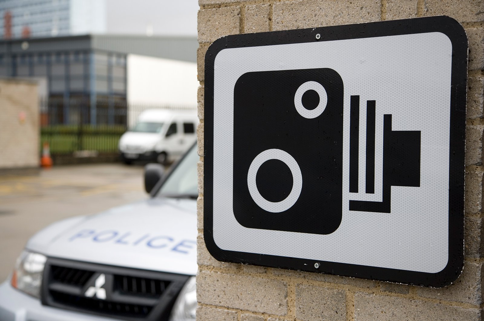 Police car & speed camera sign