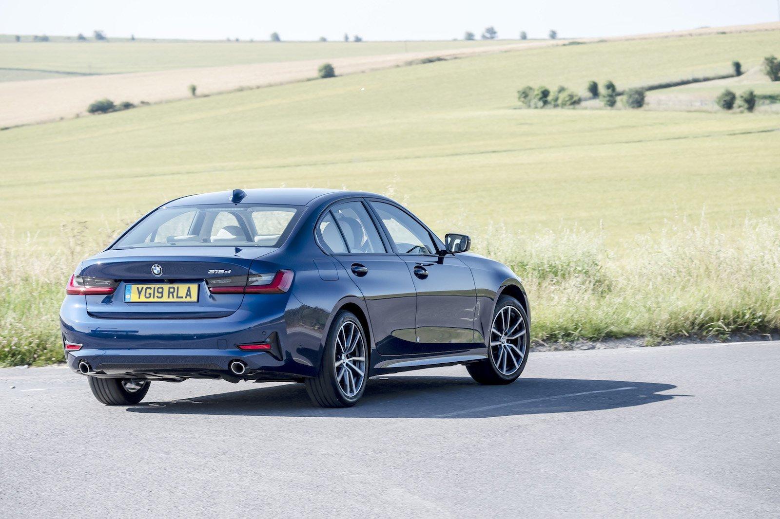 2019 bmw 3 series 318d blue driving rear