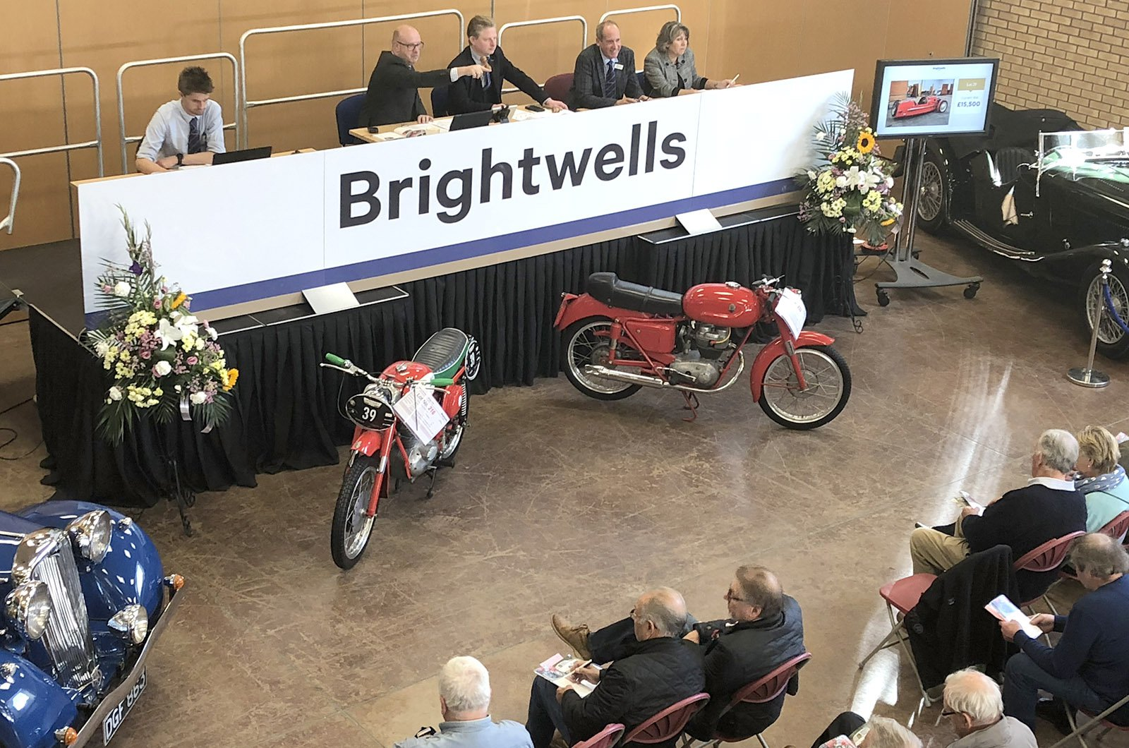 Brightwells car auction table where bidding is happening