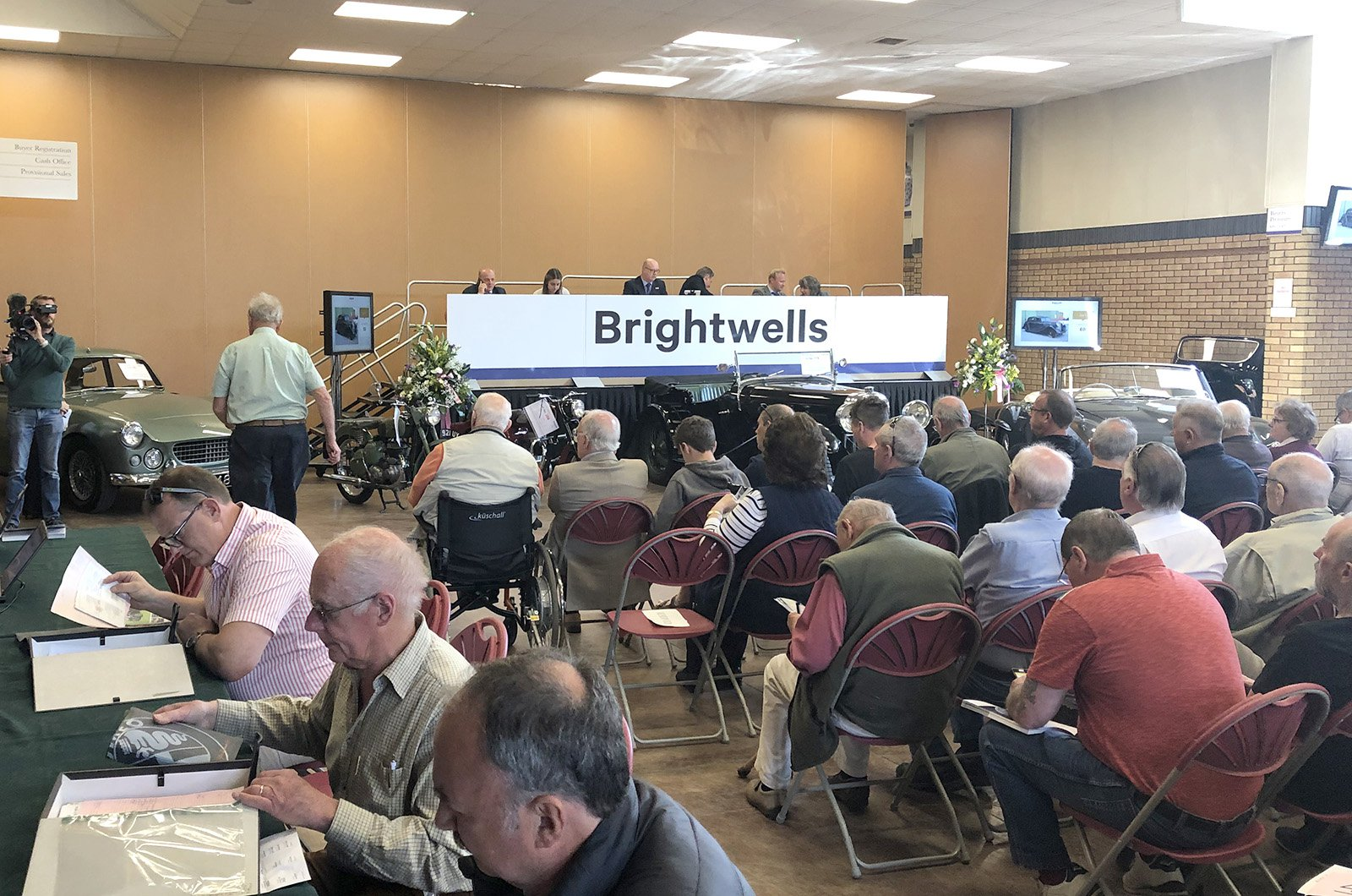 Bidders sat in front of Brightwells car auction table