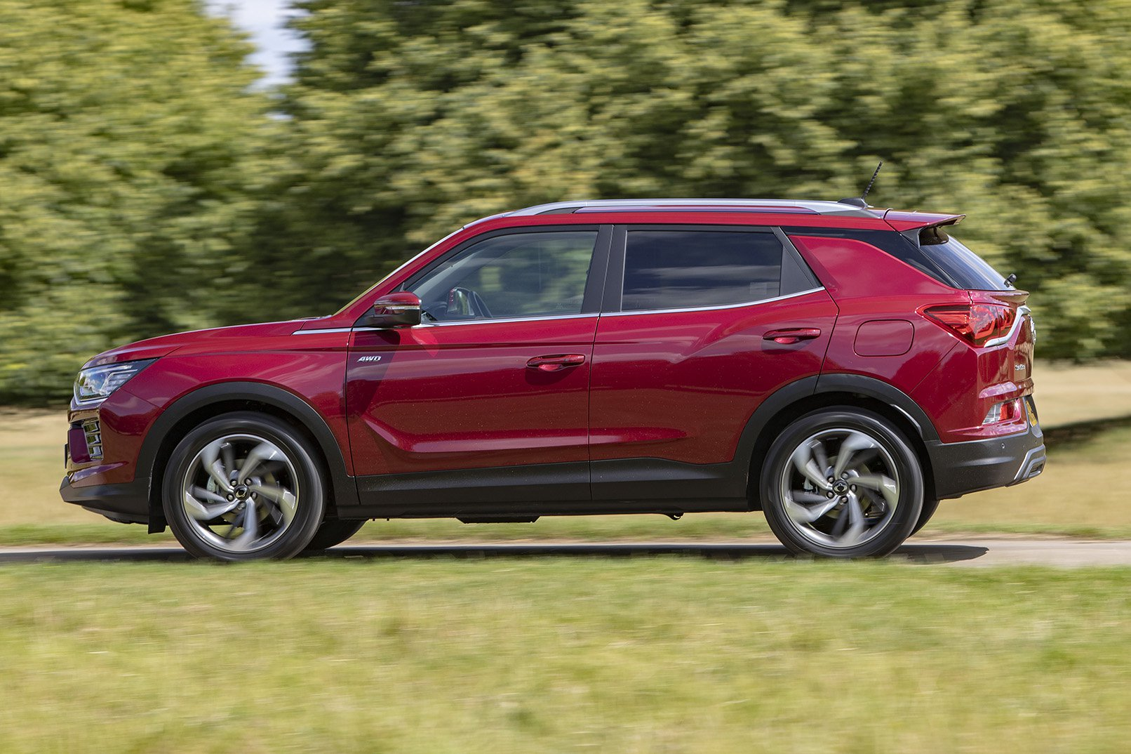 2019 ssangyong korando red side profile driving